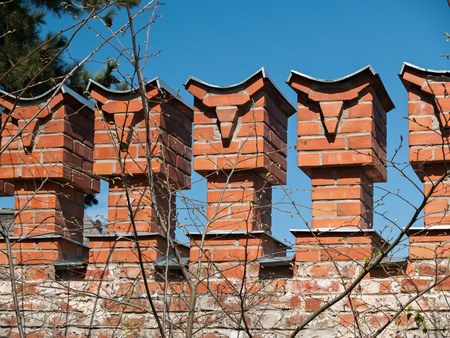 Fragment of the fortified wall of red brick in the architectural complex Fedorovsky town in the Alexander Park in Tsarskoye Selo in St. Petersburg, Russia