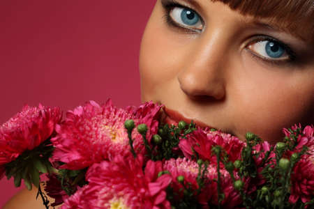 Portrait of a young woman with pink flowers photo