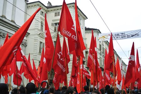 principles: Turin, Italy - 1 May 2010: demonstration for Labor Day red flags and banners
