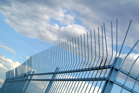 metal gate with sky in the background