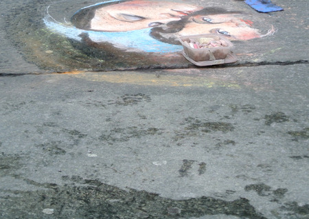 drawing on the street of madonna with child
