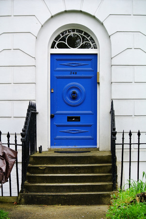 facade part of residential building with blue door