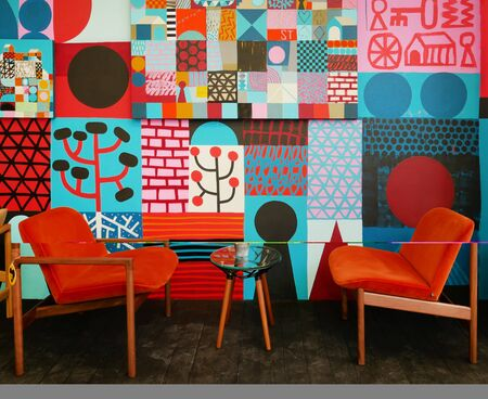 armchairs in fabric and decorated wall