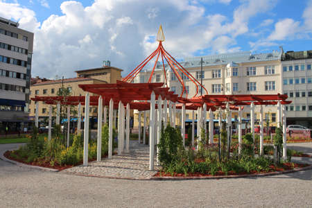 White and red pavilion in the Eastern style in one of the courtyards of the city of Lahti. Finland.