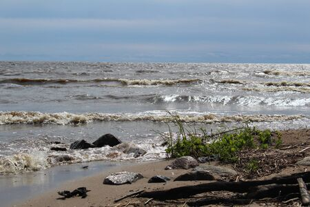 large lake with waves and shore Stock fotó
