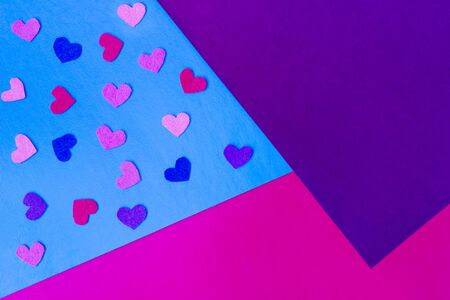 Violet, pink, blue background. Copy space. Place for text ande design. Colorful decorations. Felt hearts. Valentine's decor. Post card.