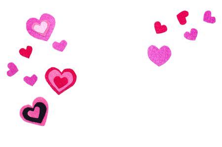 White background. Red, pink, black felt hearts. Copy space. Place for text and design. Valentine's card. Stock Photo