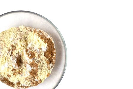 White background with flour and brown sugar in the transparent plate. Reklamní fotografie - 138175187