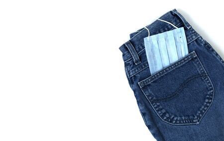 White background with blue jeans. Coronavirus concept.