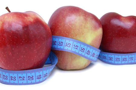 tape measure wrapped around the apples photo