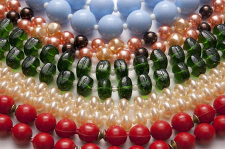 Colorful beads spread out on paper photo