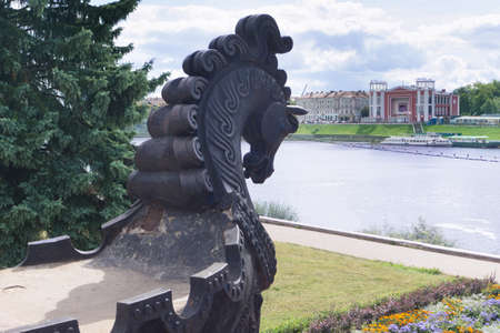 TVER - AUG 26:  View from a round cast-iron site in the form of a boat with a horses head (part of the monument Afanasy Nikitin) and Zvezda Cinema on August 26, Tver, Russia