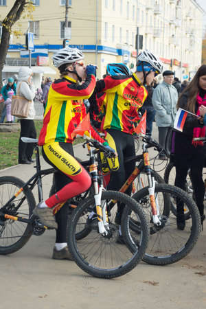 duffle: TVER, RUSSIA - OCT 11: Cyclists in duffle with the inscription Tver region on the Olympic torch relay on October 11, 2013. In the Tver region Olympic flame visited three towns: Torzhok, Tver and Rzhev