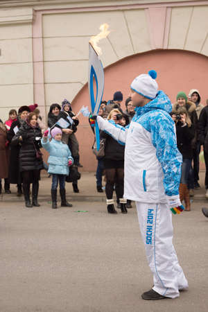 TVER, RUSSIA - MARCH 2, 2014  Torchbearer with a torch on the Paralympic Torch Relay