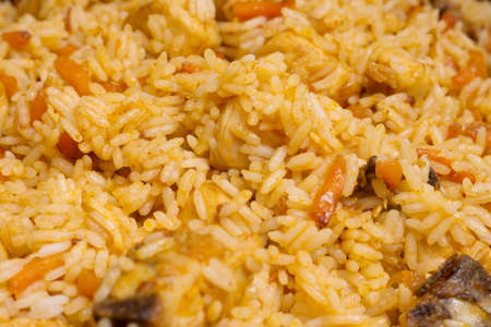 crumbly: Closeup crumbly rice with chicken - pilaf Stock Photo
