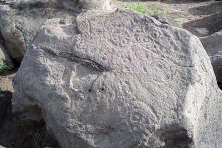 past civilizations: KHABAROVSK REGION, RUSSIA - MAY 14, 2014: Archaeological monument. Petroglyphs Sikachi-Alan