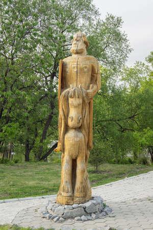 depicting: KHABAROVSK, RUSSIA - MAY 18, 2014: Wooden figures depicting one of the Three Heroes (Tri Bogatyrya) in Severniy Park