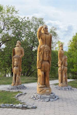 depicting: KHABAROVSK, RUSSIA - MAY 18, 2014: Wooden figures depicting the Three Heroes (Tri Bogatyrya) in Severniy Park