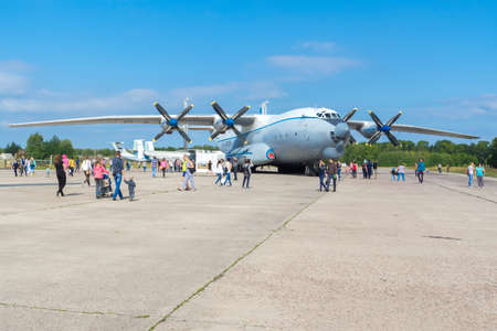 turboprop: TVER, RUSSIA - AUGUST 16, 2014: Airplane An-22 on a sunny day at the open day at the airport Migalovo. An-22 - Soviet heavy turboprop transport aircraft Editorial