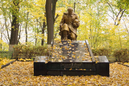 grave site: NEMAN, KALININGRAD REGION, RUSSIA - OCT 12, 2014: The sculpture at the site a mass grave of Soviet soldiers who died in January 1945, is set in 1948. Inscription - the feat of heroes is immortal