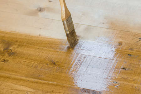home addition: Varnish brush strokes on a wooden floor Stock Photo