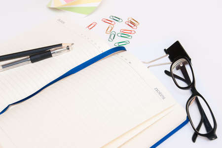open notebook: Open notebook, glasses and stationery Stock Photo