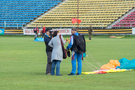 TVER, RUSSIA - AUGUST 2, 2015: Reporters interviewes the parachutist at the stadium Khimik during the celebration Day of the Airborne Forces