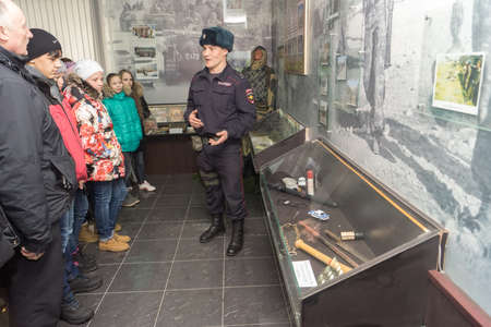 tells: TVER, RUSSIA - MARCH 24, 2015: A man holds a tour of the military unit in open day