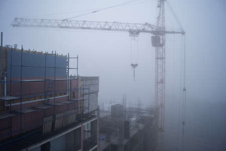 particulates: Construction site in the morning fog Stock Photo