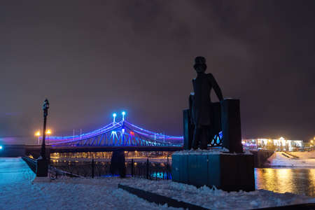 pushkin: TVER, RUSSIA - DECEMBER 15, 2015: The monument to Alexander Pushkin and Starovolzhsky bridge at night