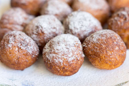 Fried dessert dusted with icing sugar