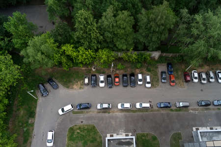 slew: car in the parking near lot of trees on the summer day Stock Photo
