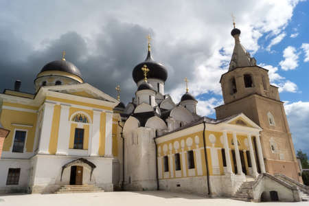sacred trinity: STARICA, TVER REGION, RUSSIA - JUNE, 13, 2016: Assumption Cathedral, Trinity Cathedral and bell tower on the territory of the Holy Dormition Monastery in Staritsa