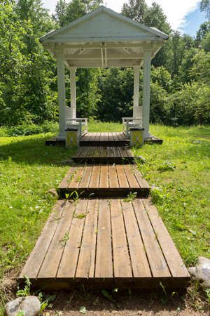 BERNOVO, TVER REGION,  RUSSIA - JUNE, 13, 2016: Wooden flooring in a white arbor on the territory of the Pushkin Museum in Bernovo Editorial