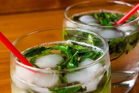 Two mojito cocktail in a glass closeup
