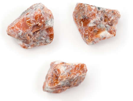Raw orange Calcite on a white background.