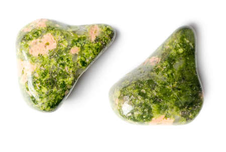 Raw unakite on a white background. Stock Photo