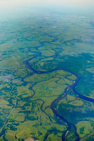 View of the confluence of the Zeya and Selemdzha rivers from the airplane window
