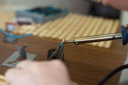 The soldering iron in the hands of man.