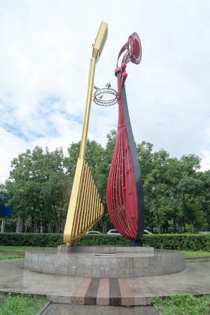 KHABAROVSK, RUSSIA - JULY, 25, 2017: Sculpture pipa and balalaika, side view.