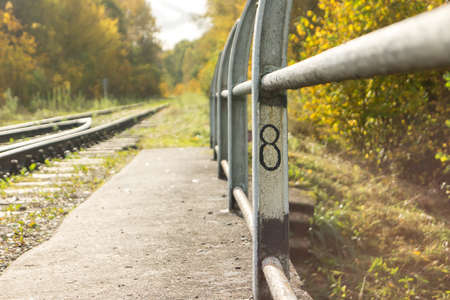 Picket with number 8 on the rails of the railway bridge