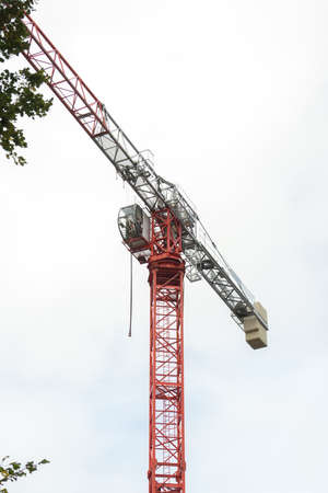 Lifting crane on cloudy sky background.  Stock Photo