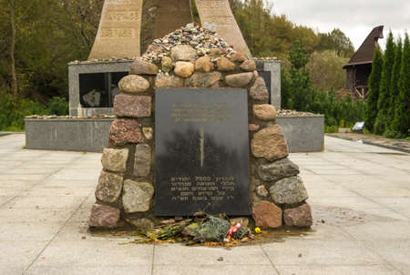 YANTARNYY, KALININGRAD OBLAST, RUSSIA - OCTOBER, 13, 2017: Memorial plate, the inscription In memory of the 7,000 victims of the Holocaust, murdered by the Nazis on 31 January 1945.