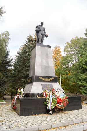 ZELENOGRADSK,  KALININGRAD REGION, RUSSIA - OCTOBER, 18, 2017:  Memorial complex on the mass grave of Soviet soldiers who died in February 1945 and funeral wreaths, the inscription on the plate indicates who is buried.