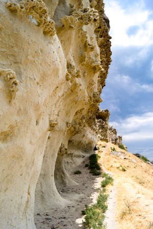 Footpath along weathered rock in the mountains of Crimea near the cave city of Bakla
