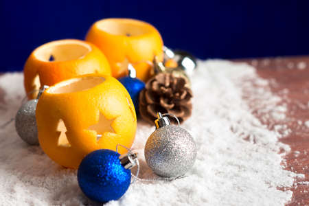 Christmas still life with orange candlesticks and balls