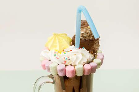 Chocolate freakshake with waffles and marshmallows Imagens
