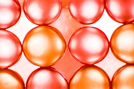 Abstract background of bright red and orange balls and light