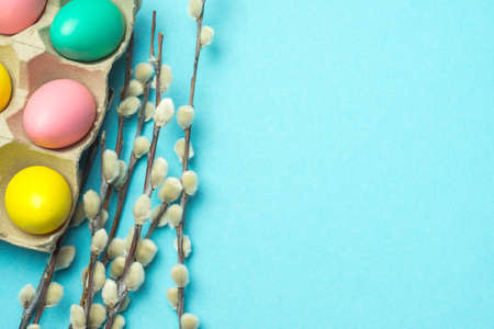 Easter blue background with eggs and willow