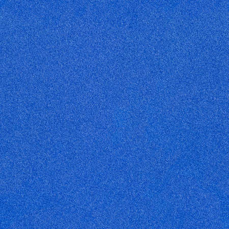 The surface texture of foamiran. Blue synthetic sponge background